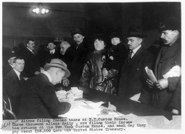 Aliens filing income taxes, c. 1914-1920. Photo courtesy of thje Library of Congress.